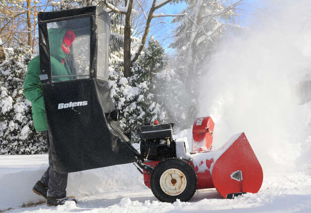 Frank Mosher uses a snowblower on his driveway on the side of his house on Friday, Jan. 3, 2014 in Delmar, N.Y. (Lori Van Buren / Times Union) Photo: Lori Van Buren / 00025215A
