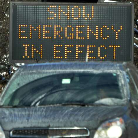 A snow emergency sign in Washington Park  Friday Jan. 3, 2014, in Albany, NY.  (John Carl D'Annibale / Times Union) Photo: John Carl D'Annibale / 00025215A