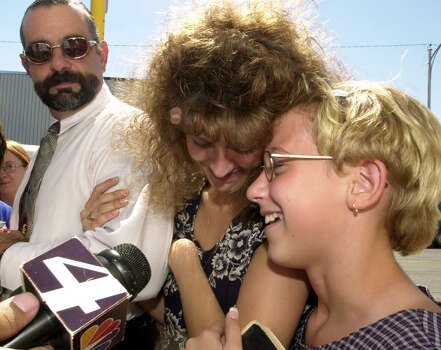 Tommy Lynn Sells' victim Krystal Surles (right), 11, and Crystal Harris, mother of 13-year-old victim Kaylene Harris,  share a happy moment as they leave the Val Verde Justice Center on Sept. 18, 2000, after hearing the guilty verdict in Sells' trial. The jury deliberated for a little more than an hour before finding Tommy Lynn Sells guilty of capital murder. Terry Harris, stepfather of Kaylene, is on the left. Sells was sentenced to death for Kaylene's December 1999 murder. Photo: GLORIA FERNIZ, San Antonio Express-News / SAN ANTONIO EXPRESS-NEWS