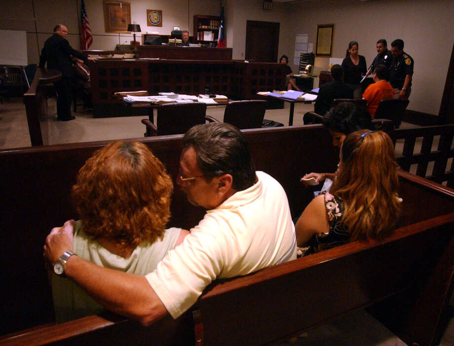 The family of  Mary Bea Perez comfort each other as Tommy Lynn Sells pleads guilty to capital murder charges for strangling the 9 year old on Sept. 11, 2003, at the Bexar County Justice Center.