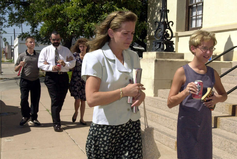 Krystal Surles, 11, and her mother Pam Surles leave the Val Verde Justice Center on Sept. 18, 2000, after a guilty verdict in the capital murder trial of Tommy Lynn Sells was announced. The family of 13-year-old Kaylene Harris, who was killed by Sells — Justin (from left), 14, Terry and Crystal — walk behind them. Photo: GLORIA FERNIZ, San Antonio Express-News / SAN ANTONIO EXPRESS-NEWS