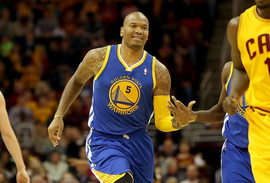 In his first season with the Warriors, big man Marreese Speights has made contributions both on the floor and off. Photo: Mike Lawrie, Getty Images