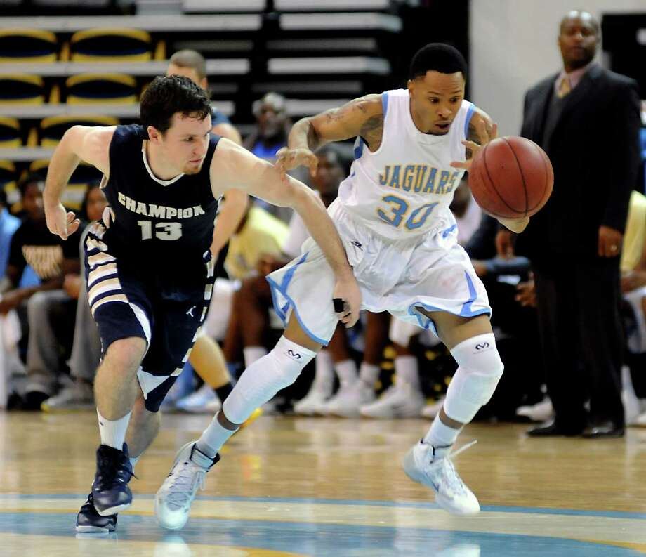 Southern's Tre Lynch, right, runs down a loose ball ahead of Champion Baptist's Tim Gillespie,left, Monday Dec. 30, 2013, during an NCAA college basketball game in Baton Rouge, La.  Southern defeated Champion Baptist 116-12. (AP Photo/The Advocate, John Oubre)  ORG XMIT: LABAT101 Photo: John Oubre / The Baton Rouge Advocate