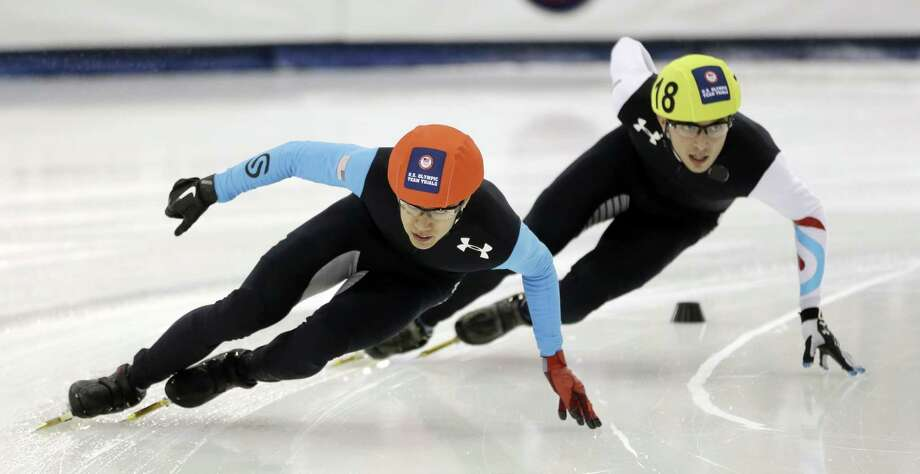 J.R. Celski, left, and Kyle Carr, right, competes in the men's 1,500 meters during the U.S. Olympic short track trials, Friday, Jan. 3, 2014, in Kearns, Utah. (AP Photo/Rick Bowmer)  ORG XMIT: UTRB101 Photo: Rick Bowmer / AP
