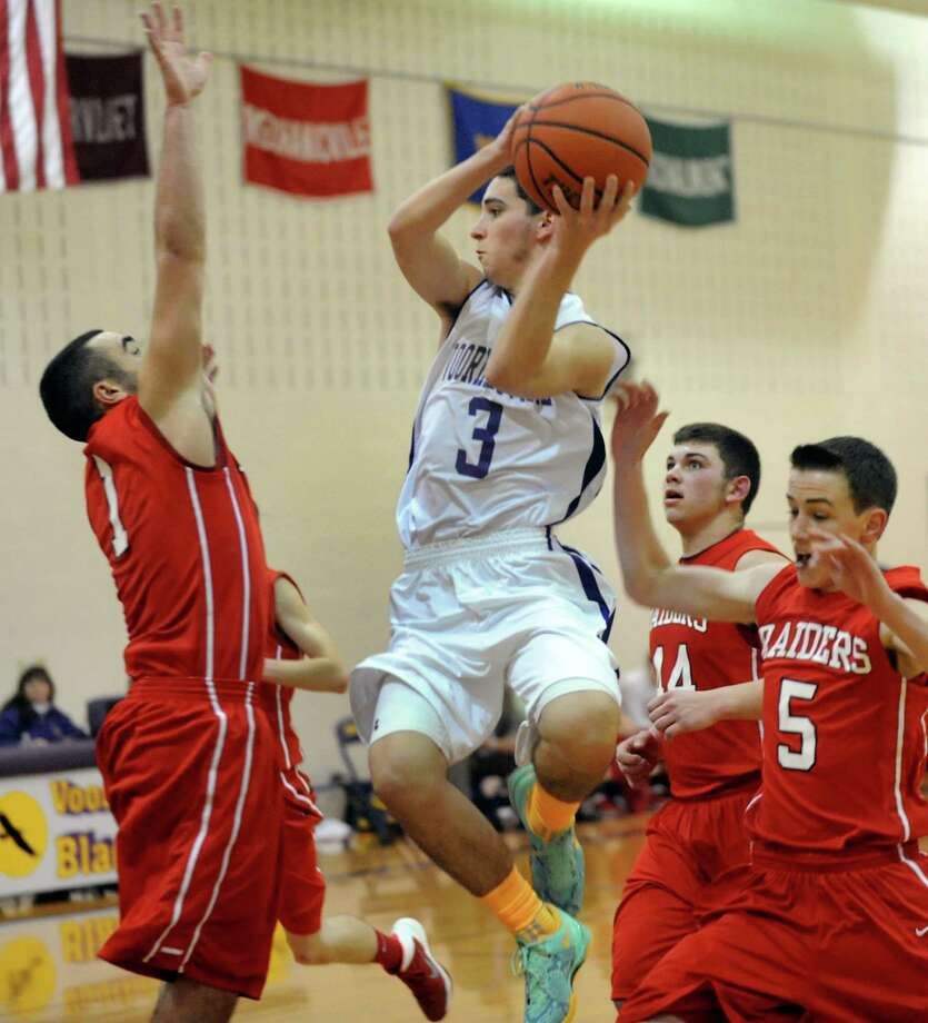 Voorheesville's Dylan Hensel, center, goes to the hoop as Mechanicville's Nico Dumas, left, defends during their basketball game on Friday, Jan. 3, 2014, at Voorheesville High in Voorheesville, N.Y. (Cindy Schultz / Times Union) Photo: Cindy Schultz / 00025225A