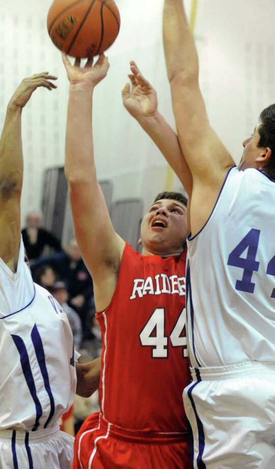 Mechanicville's C.J. Tironi, center, shoots for the hoop during their basketball game against Voorheesville on Friday, Jan. 3, 2014, at Voorheesville High in Voorheesville, N.Y. (Cindy Schultz / Times Union) Photo: Cindy Schultz / 00025225A