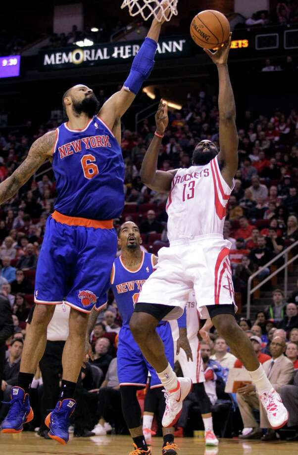 Houston Rockets guard James Harden (13) takes a shot over New York Knicks center Tyson Chandler (6) during the fourth quarter of an NBA basketball game, Friday, Jan. 3, 2014, in Houston. The Rockets defeated the Knicks 102-100. (AP Photo/Patric Schneider) ORG XMIT: TXPX121 Photo: Patric Schneider / FR170473 AP