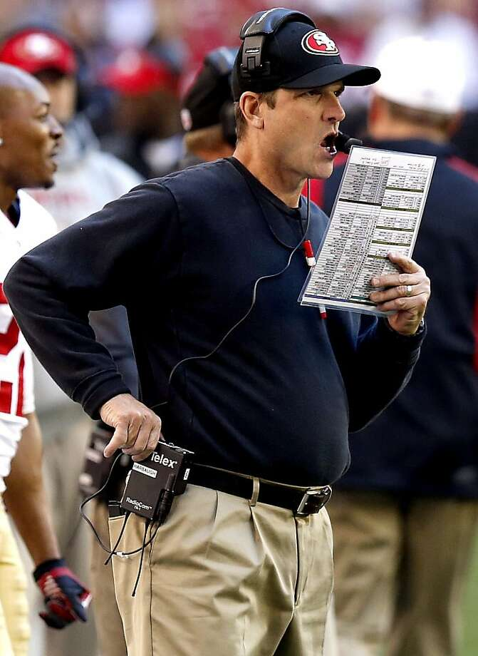 The 49ers' Jim Harbaugh (left) and Stanford's David Shaw (right) have each shown they can be stubborn when it comes to their play calling. Photo: Ross D. Franklin, Associated Press