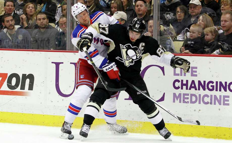 PITTSBURGH, PA - JANUARY 03:  Sidney Crosby #87 of the Pittsburgh Penguins handles the puck in front of Anton Stralman #6 of the New York Rangers during the game at Consol Energy Center on January 3, 2014 in Pittsburgh, Pennsylvania.  The Penguins defeated the Rangers 5-2.  (Photo by Justin K. Aller/Getty Images) ORG XMIT: 181112812 Photo: Justin K. Aller / 2014 Getty Images