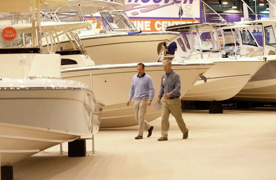 Skip Pillsbury, left, and Steve Camp with Marine Max look over the display area at the 59th Annual Houston International Boat, Sport & Travel Show. Photo: Johnny Hanson, Staff / © 2014  Houston Chronicle