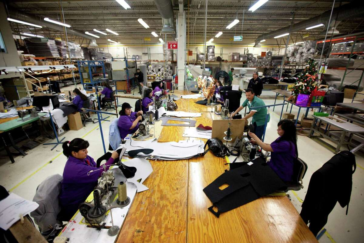 In this Friday, Dec.27, 2013 photo, workers manufacture car dash mats at a maquiladora belonging to the TECMA group in Ciudad Juarez, Mexico. (AP Photo/Ivan Pierre Aguirre)