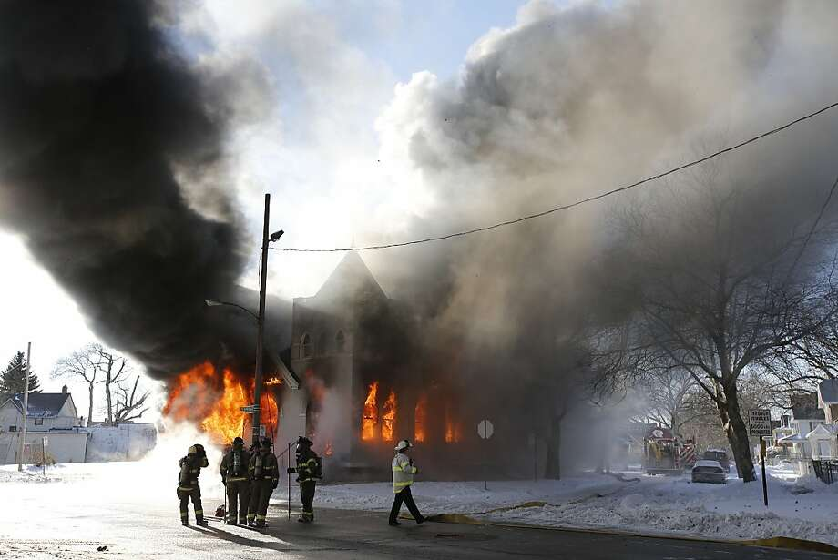 NAME OF CHURCH IS ST. MARK BAPTIST CHURCH, NOT SAINT MARK'S - Toledo firefighters battle a fire at St. Mark Baptist Church in Toledo, Ohio, Friday, Jan. 3, 2014. (AP Photo/The Blade, Jeremy Wadsworth)  MANDATORY CREDIT; MAGS OUT; NO SALES; TV OUT; SENTINEL-TRIBUNE OUT; MONROE EVENING NEWS OUT; TOLEDO FREE PRESS OUT Photo: Jeremy Wadsworth, Associated Press