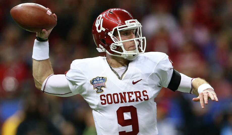 Trevor Knight looks to throw against the Crimson Tide in the Sugar Bowl. OU coach Bob Stoops made the redshirt freshman his starting quarterback before the beginning of the season. Photo: Streeter Lecka / Getty Images / 2014 Getty Images