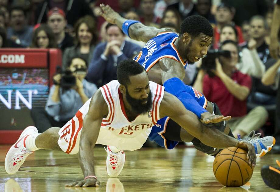 Jan. 3: Rockets 102, Knicks 100  Rockets guard James Harden dives for a loose ball against New York Knicks guard Iman Shumpert during the second half at Toyota Center on Friday, Jan. 3, 2014. Photo: Smiley N. Pool, Houston Chronicle