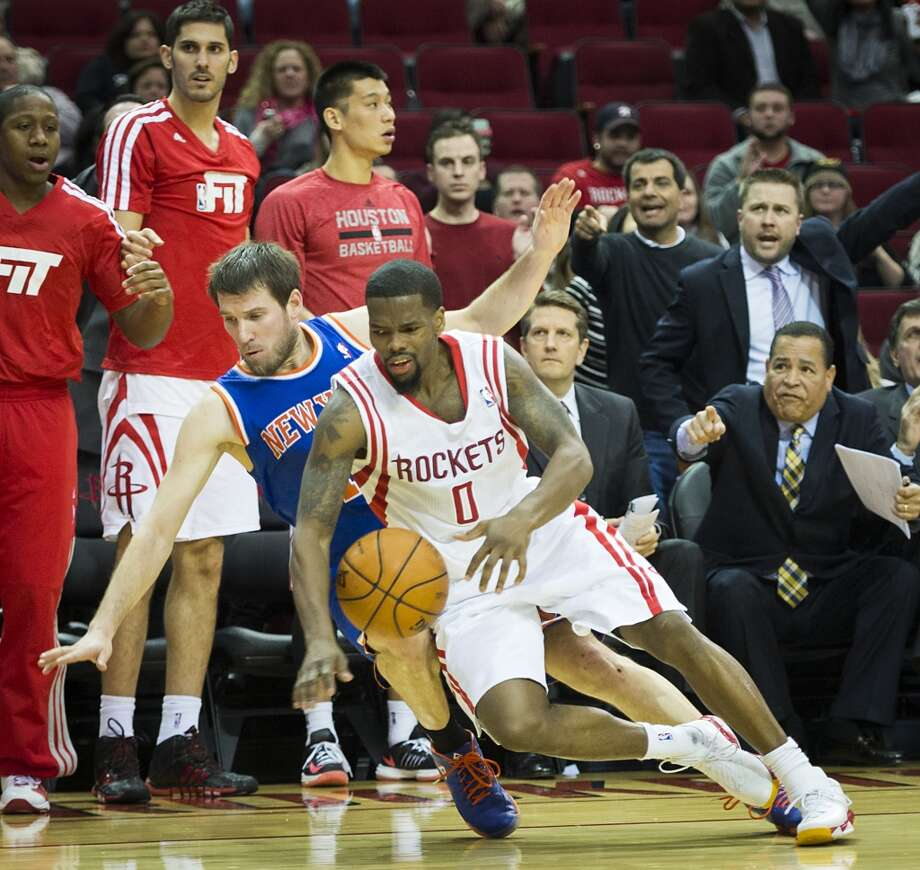 Rockets guard Aaron Brooks is fouled by the Knicks Beno Udrih during the final minute. Brooks hit both free throws to give the Rockets a 102-100 win. Photo: Smiley N. Pool, Houston Chronicle