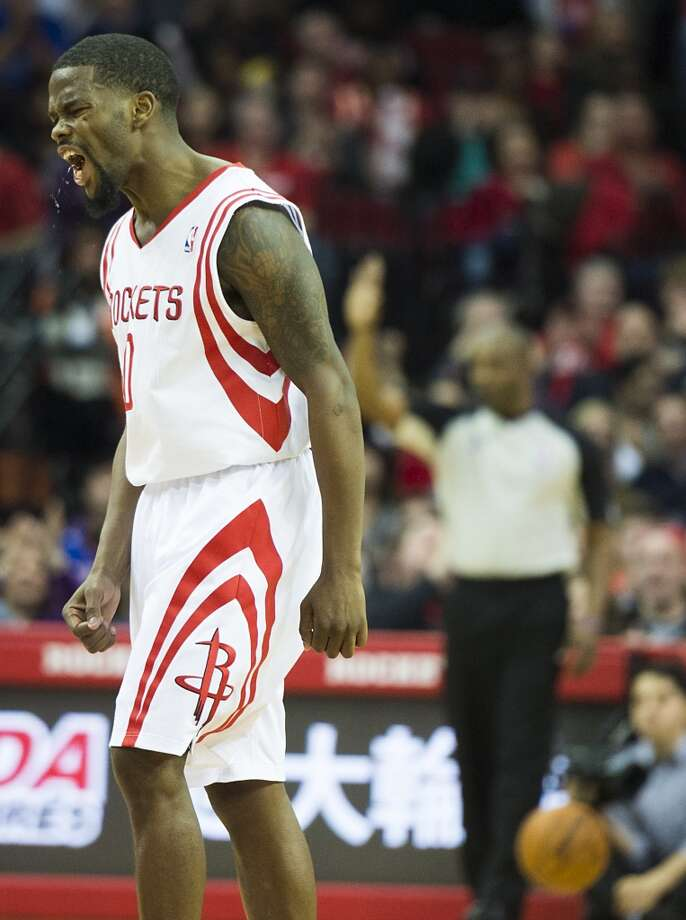 Rockets point guard Aaron Brooks reacts after sinking a shot during the second half. Photo: Smiley N. Pool, Houston Chronicle