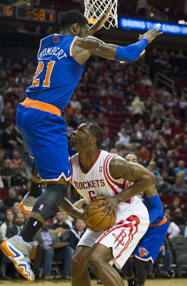 Rockets forward Terrence Jones has his path to the basket blocked by Knicks guard Iman Shumpert. Photo: Smiley N. Pool, Houston Chronicle