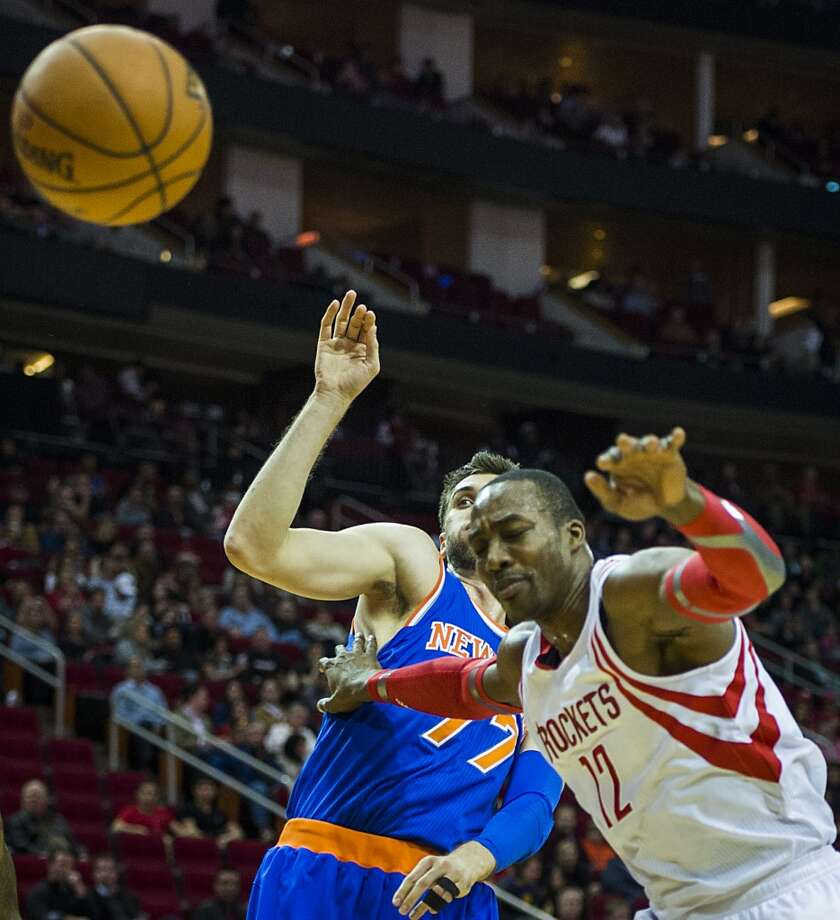 Dwight Howard has the ball knocked away by the Knicks Andrea Bargnani. Photo: Smiley N. Pool, Houston Chronicle