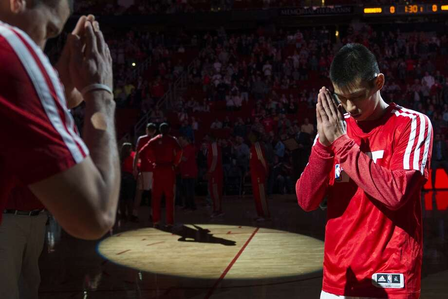 Rockets point guard Jeremy Lin, right, and shooting guard Francisco Garcia bow toward each other before the game. Photo: Smiley N. Pool, Houston Chronicle