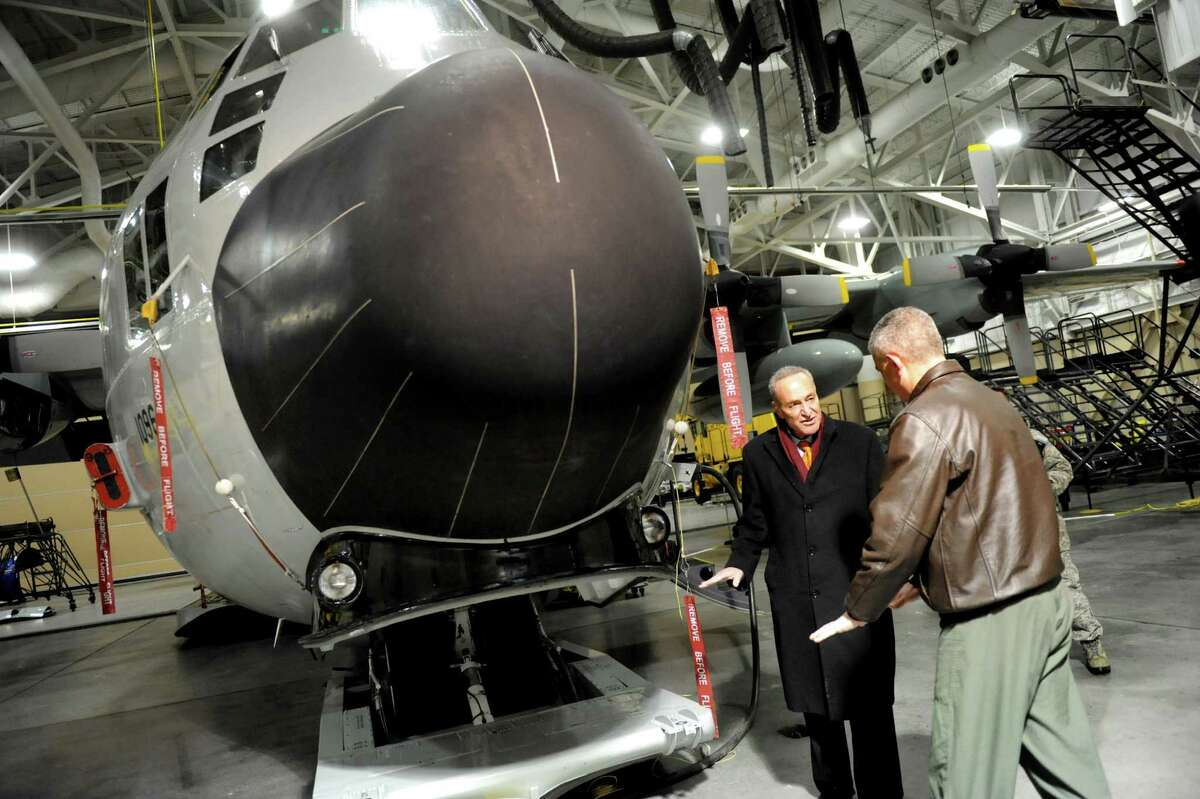 Sen. Chuck Schumer, left, examines a ski-equipped LC-130 aircraft at the 109th Airlift Wing with Col. Shawn Clouthier on Friday, Jan. 3, 2014, at Stratton Air National Guard Base in Scotia, N.Y. Schumer toured the base and vowed to fight to maintain current levels of funding from the National Science Foundation. (Cindy Schultz / Times Union)