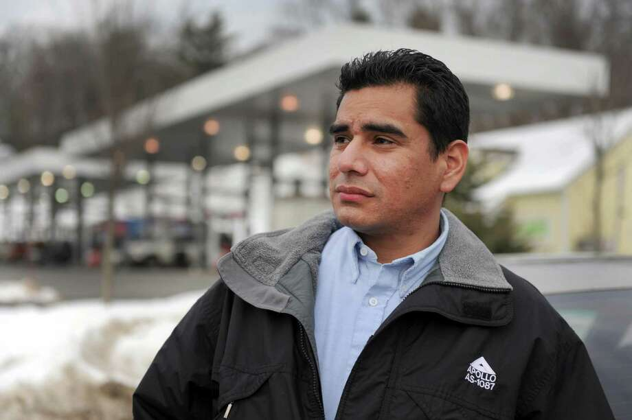 Jerry Valdez talks about a fire he witnessed at the Wheels Gas Station on Tamarack Avenue in Danbury on Dec. 20, 2013. The cause of the explosion that injured a Danbury man is unknown at this time. Photo: Carol Kaliff / The News-Times