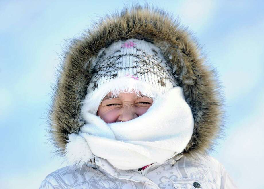 Nicole Lasko, 7, of Greenwich, closes her eyes while attempting to stay warm during sled riding at the Western Greeenwich Civic Center, Greenwich, Conn., Friday afternnon, Jan. 3, 2014, during the aftermath of the snow storm that hit the area. Photo: Bob Luckey / Greenwich Time