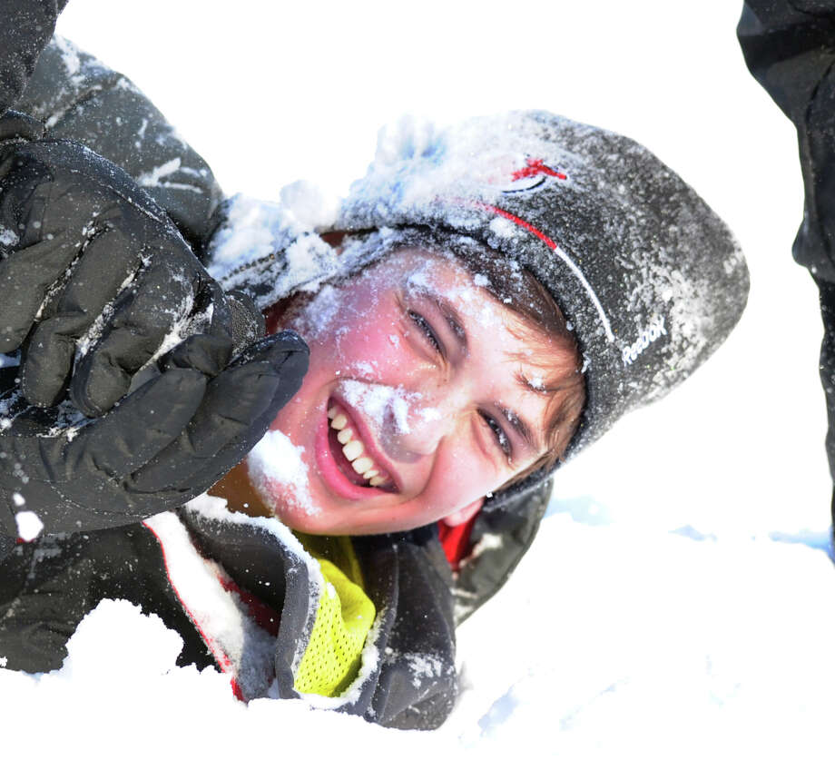 Ben Presley, 11, of Greenwich, got covered with snow while sled riding at the Western Greeenwich Civic Center, Greenwich, Conn., Friday afternnon, Jan. 3, 2014, during the aftermath of the snow storm that hit the area. Photo: Bob Luckey / Greenwich Time