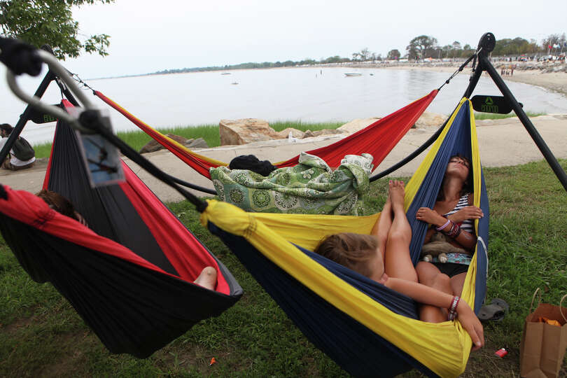 Sierra DiMartino, left, and Leila Smith, both of MA, share a hammock at the 18th annual Gathering of