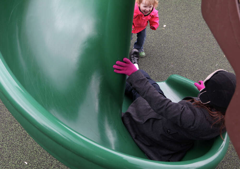 Emma Petrillo, 2, of Milford, greets her mother, Lori,  at the bottom of the slide at Bodie's Place in Eisenhower Park in Milford, Conn. on Monday, March 25, 3013. Photo: BK Angeletti, B.K. Angeletti / Connecticut Post freelance B.K. Angeletti