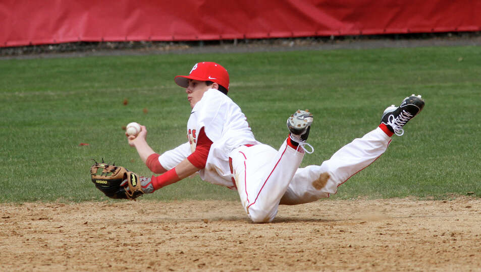 Fairfield Prep's Austin Crane, 22, makes a catch and diving throw during a game against Notre Dame -