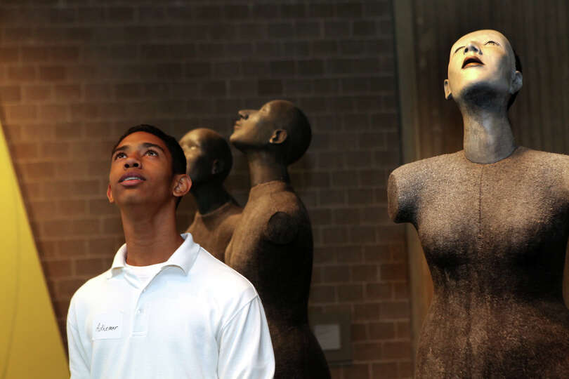 Bridgeport  Roosevelt student Adhemar Leonardo poses in Yale Art Gallery entry during a visit as par