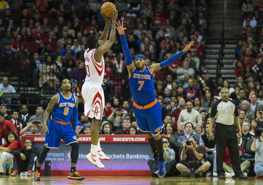 Rockets guard James Harden makes a jumper over Knicks forward Carmelo Anthony to give the Rockets a 100-95 lead with 02:25 left to play. Photo: Smiley N. Pool, Houston Chronicle