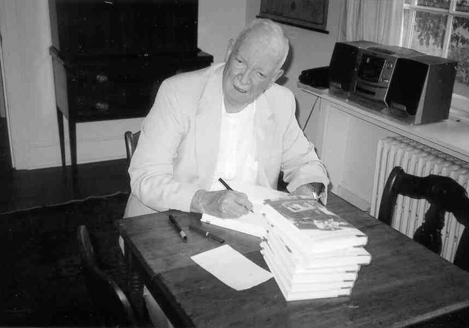 John Eisenhower took time out one summer day, while visiting at my sisterís farm, to sign copies of his new book, ìGeneral Ike,î for us. Photo: Anne W. Semmes / Greenwich Citizen