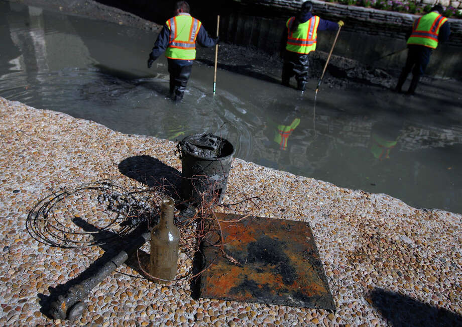 Pipes, wires bottles and buckets were just a few of the things workers found in 2010. Photo: JOHN DAVENPORT, San Antonio Express-News / jdavenport@express-news.net