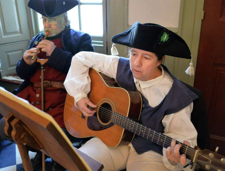 Members of Rural Felicity, Walter Soloniewicz, left, of Schenectady and Lynne Skaskiw of Delmar perform Christmas Carols as 18C. musicians during the annual Twelfth Night Celebration at the Schuyler Mansion State Historic Site Saturday Jan. 4, 2014, in Albany, NY.  (John Carl D'Annibale / Times Union) Photo: John Carl D'Annibale / 00025218A