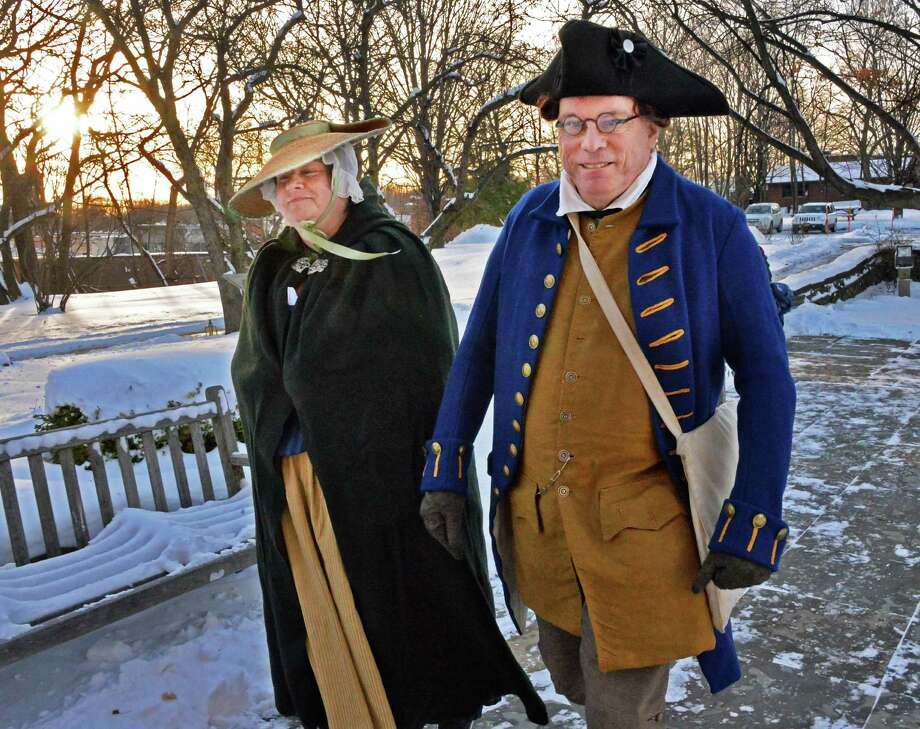18C. reenactors Ruth and Stuart Lehman of Guilderland arrive for the annual Twelfth Night Celebration at the Schuyler Mansion State Historic Site Saturday Jan. 4, 2014, in Albany, NY.  (John Carl D'Annibale / Times Union) Photo: John Carl D'Annibale / 00025218A