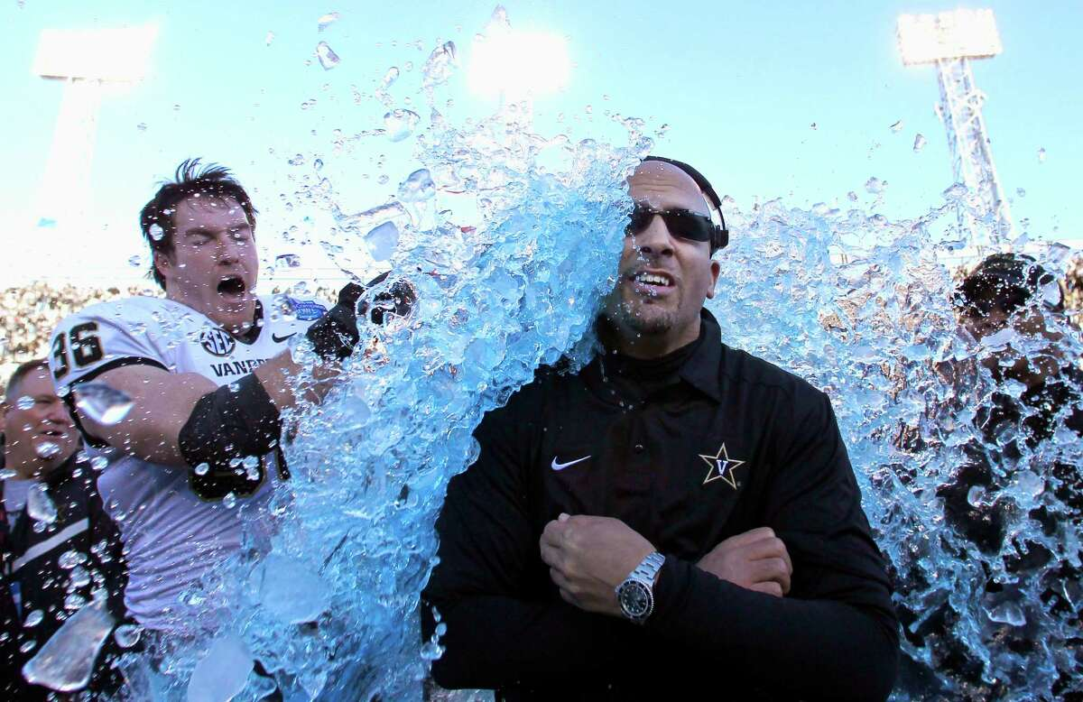 Vanderbilt coach James Franklin is doused by linebacker Chase Garnham (36) after they defeated Houston 41-24 in the BBVA Compass Bowl on Jan. 4, 2014, in Birmingham, Ala.