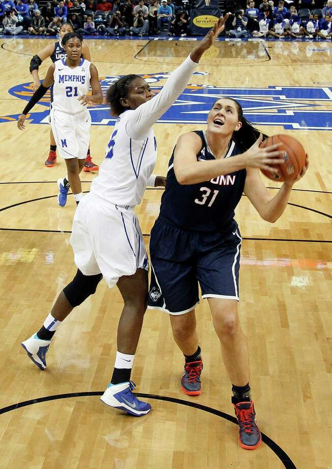Connecticut center Stefanie Dolson (31) drives against Memphis forward Pa'Sonna Hope (15) in the second half of an NCAA college basketball game Saturday, Jan. 4, 2014, in Memphis, Tenn. Connecticut won 90-49. (AP Photo/Mark Humphrey) Photo: Mark Humphrey, Associated Press / Associated Press