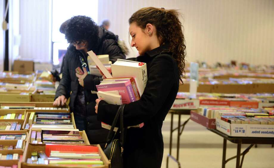 Ashley Castro, 19, of Trumbull, shops for cook books at the Friends of the Trumbull Library Book Nook Sale Saturday, Jan. 4, 2013 at the library. The sale is held monthly on the first Saturday through June and book donations are accepted during the sale days. The next sale is Feb. 2 from 9-3. Photo: Autumn Driscoll / Connecticut Post