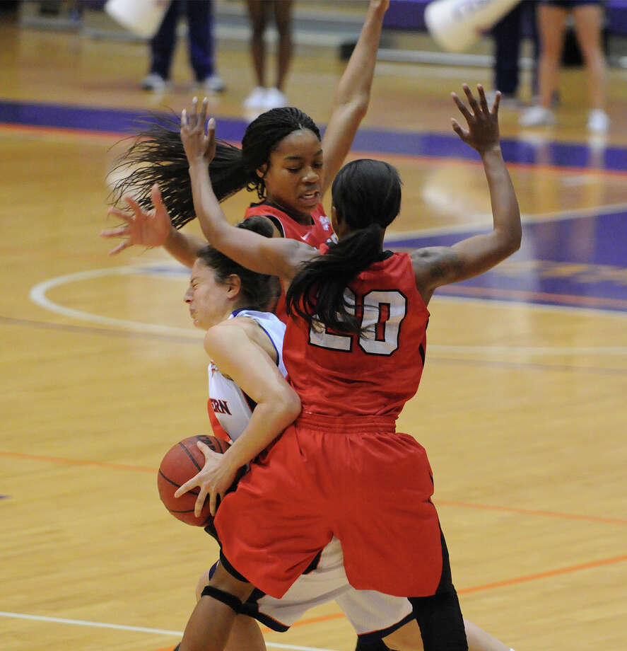 Lamar's JaMeisha Edwards (No. 20) defends a Northwestern State player during Saturday's game. Edwards scored a career-high 28 points as Lamar defeated NSU 84-79. Courtesy of NSU Photo Lab