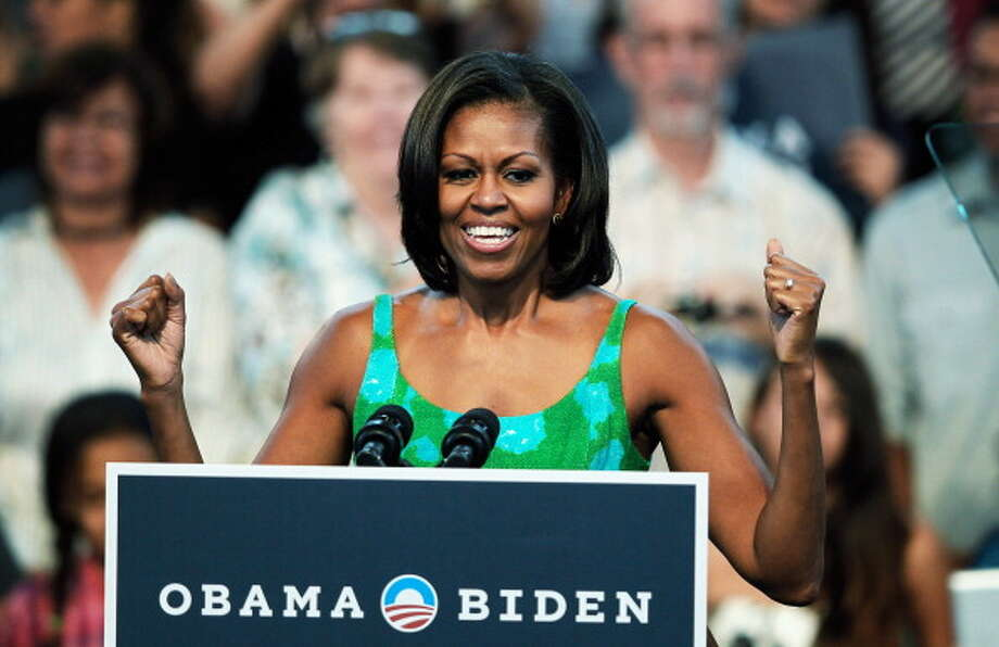 First lady Michelle Obama ranks as the 3rd most admired woman of 2013, having been named by 5 percent of poll respondents. Photo: Joe Raedle, Getty Images / 2012 Getty Images