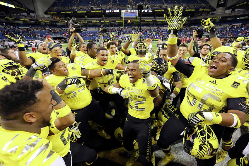 Members of the West team celebrate after the U.S. Army All-American Bowl with the East team Saturday Jan. 4, 2014 at the Alamodome. The West won 28-6.