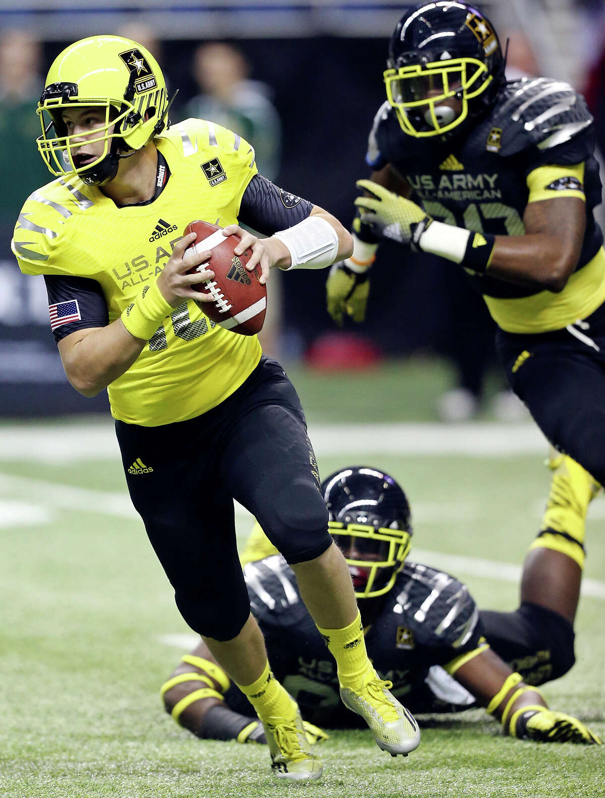 West's Kyle Allen looks for running room around East defenders during first half action of the U.S. Army All-American Bowl Saturday Jan. 4, 2014 at the Alamodome.