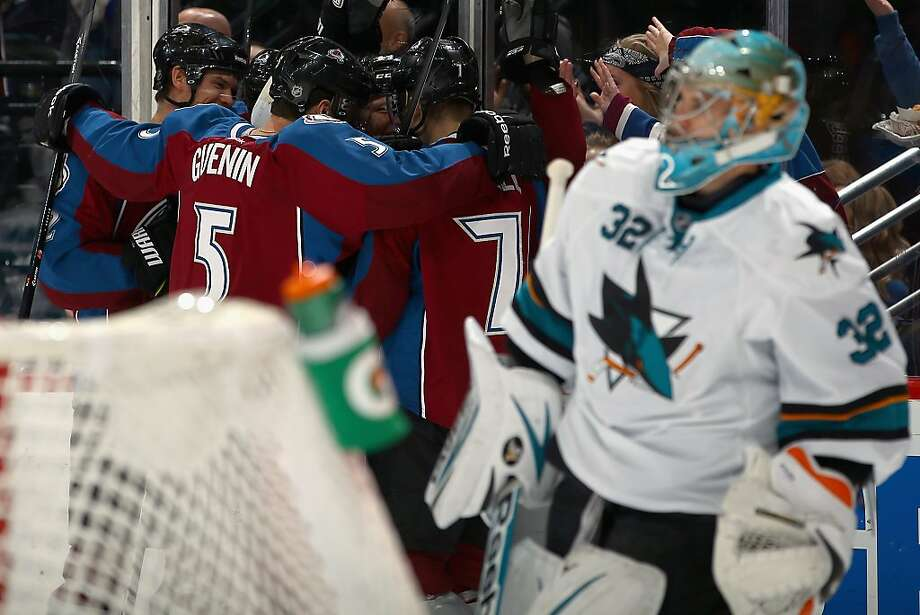 Colorado players celebrate behind goalie Alex Stalock after Nathan MacKinnon's second-period goal. Photo: Doug Pensinger, Getty Images