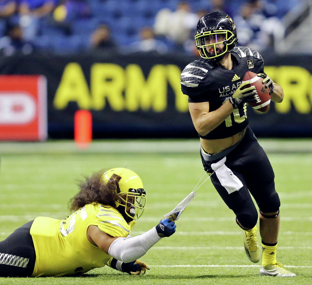 West's Ainuu Taua tries to tackle East's Jacob Park during second half action of the U.S. Army All-American Bowl Saturday Jan. 4, 2014 at the Alamodome. The West won 28-6.