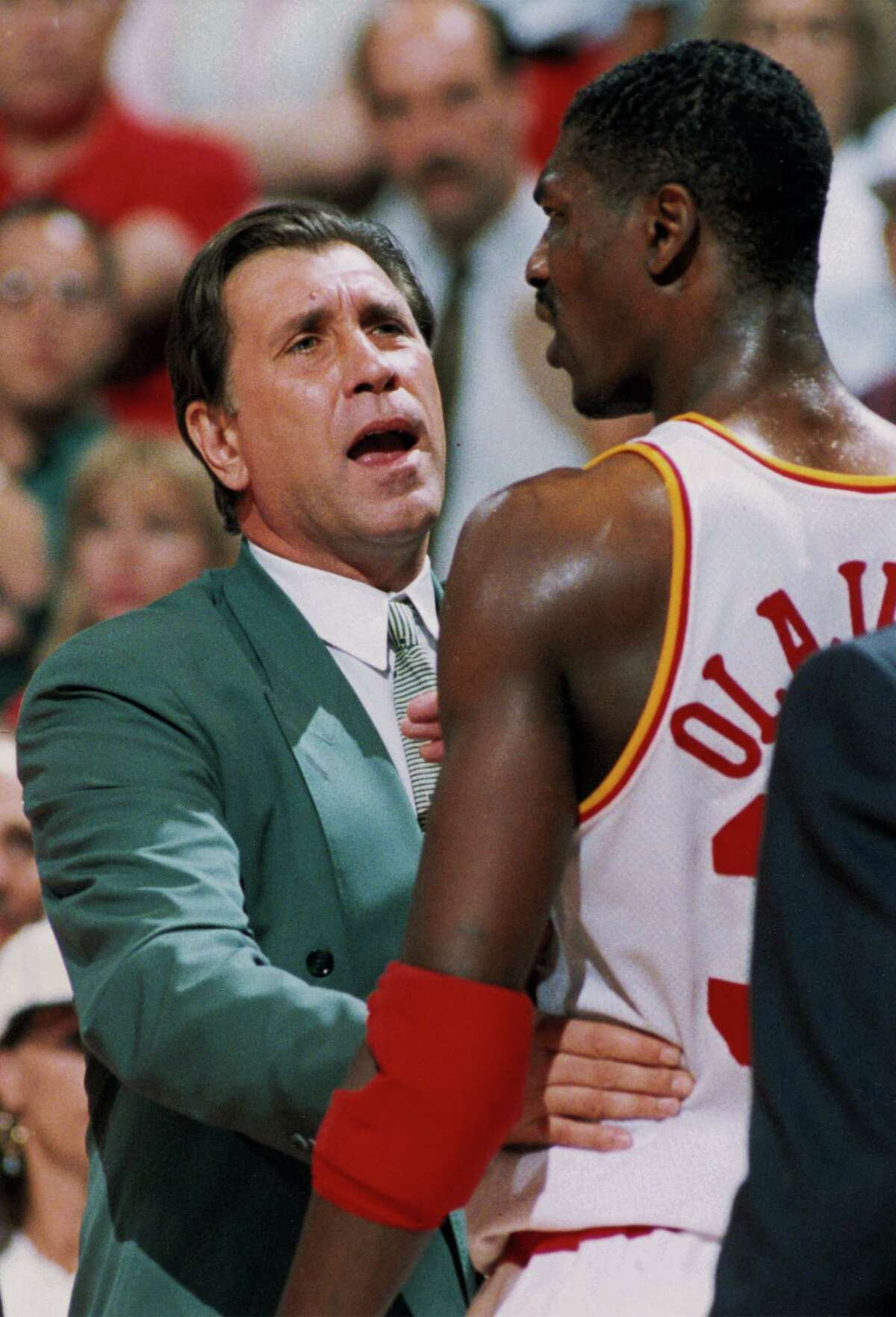 Coach Rudy Tomjanovich, left, and Hakeem Olajuwon found a way to work together in leading the Rockets to back-to-back NBA championships.