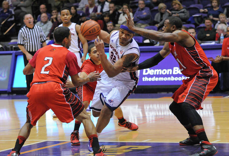 Northwestern State's DeQuan Hicks (No. 32) tries to drive in between Lamar's Anthony Holliday (No. 2) and Donovan Ross (No. 21) during Saturday's game. -- Courtesy of NSU Photo Lab