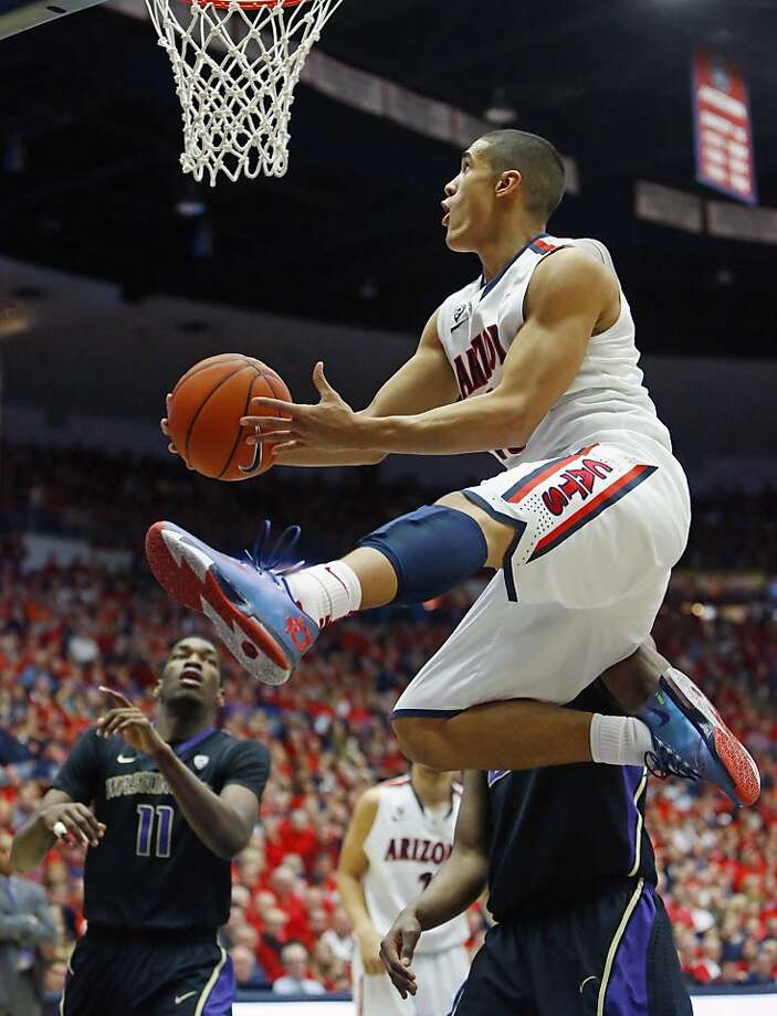Arizona guard Nick Johnson goes airborne on his way to 24 points against Washington. Photo: David Kadlubowski, Associated Press