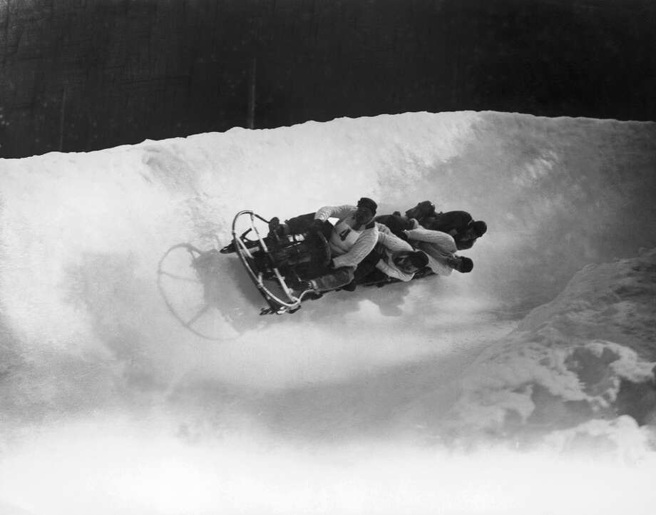 The British four-man bobsleigh team — Ralph Broome, Thomas Arnold, Alexander Richardson and Rodney Soher — is seen in action at the Winter Olympics at Chamonix, France, in February 1924. The team took the silver medal in the games. Photo: Topical Press Agency, Getty Images / 2005 Getty Images