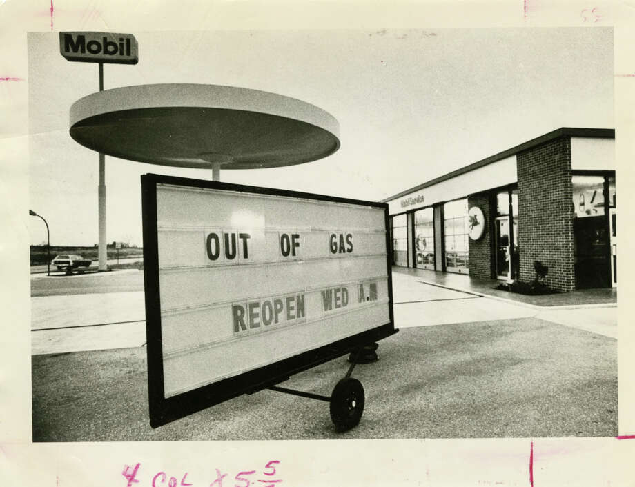 "Motorists hoping to fill up on New Year's Eve in 1973 were greeted by locked pumps and an ""OUT OF GAS"" sign at this service station on U.S. 290. Four decades later, the problem is too much oil. Photo: Curtis McGee, HC Staff / Houston Chronicle"